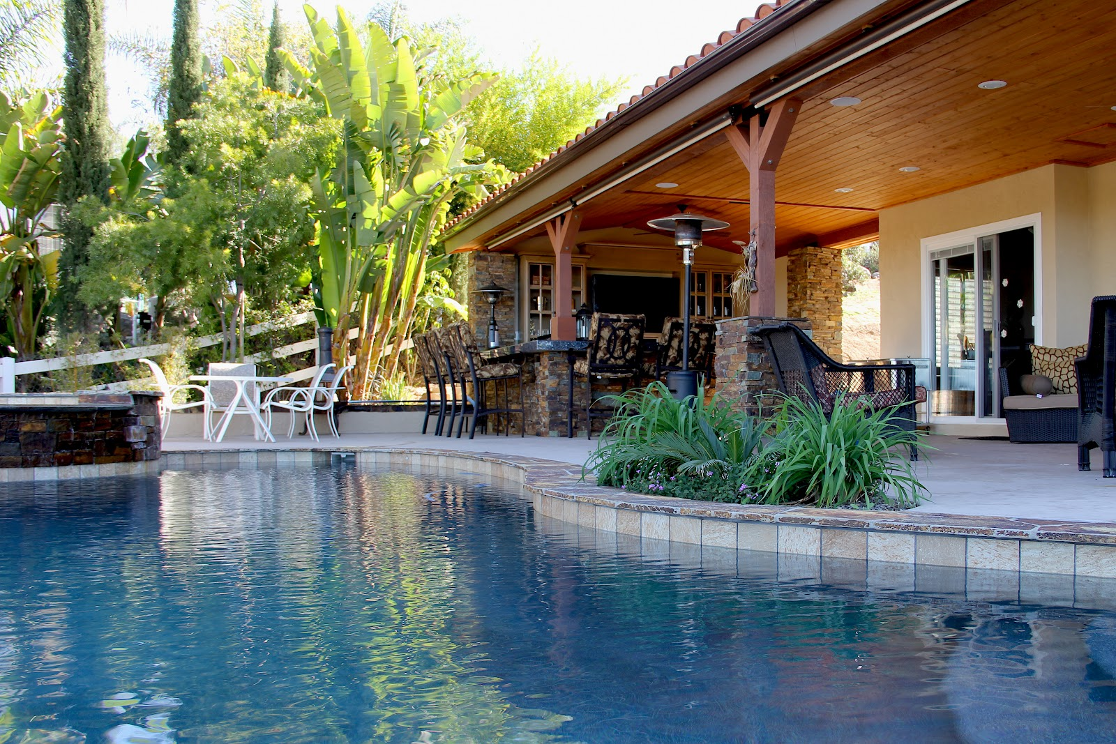 outdoor kitchen and pool photo - 4
