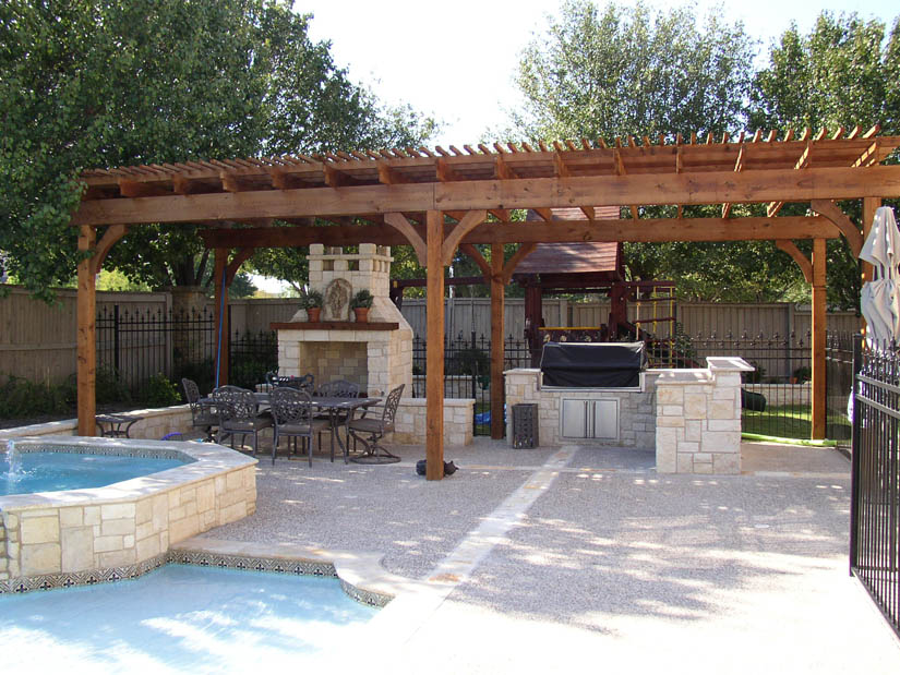 outdoor kitchen and pool photo - 5