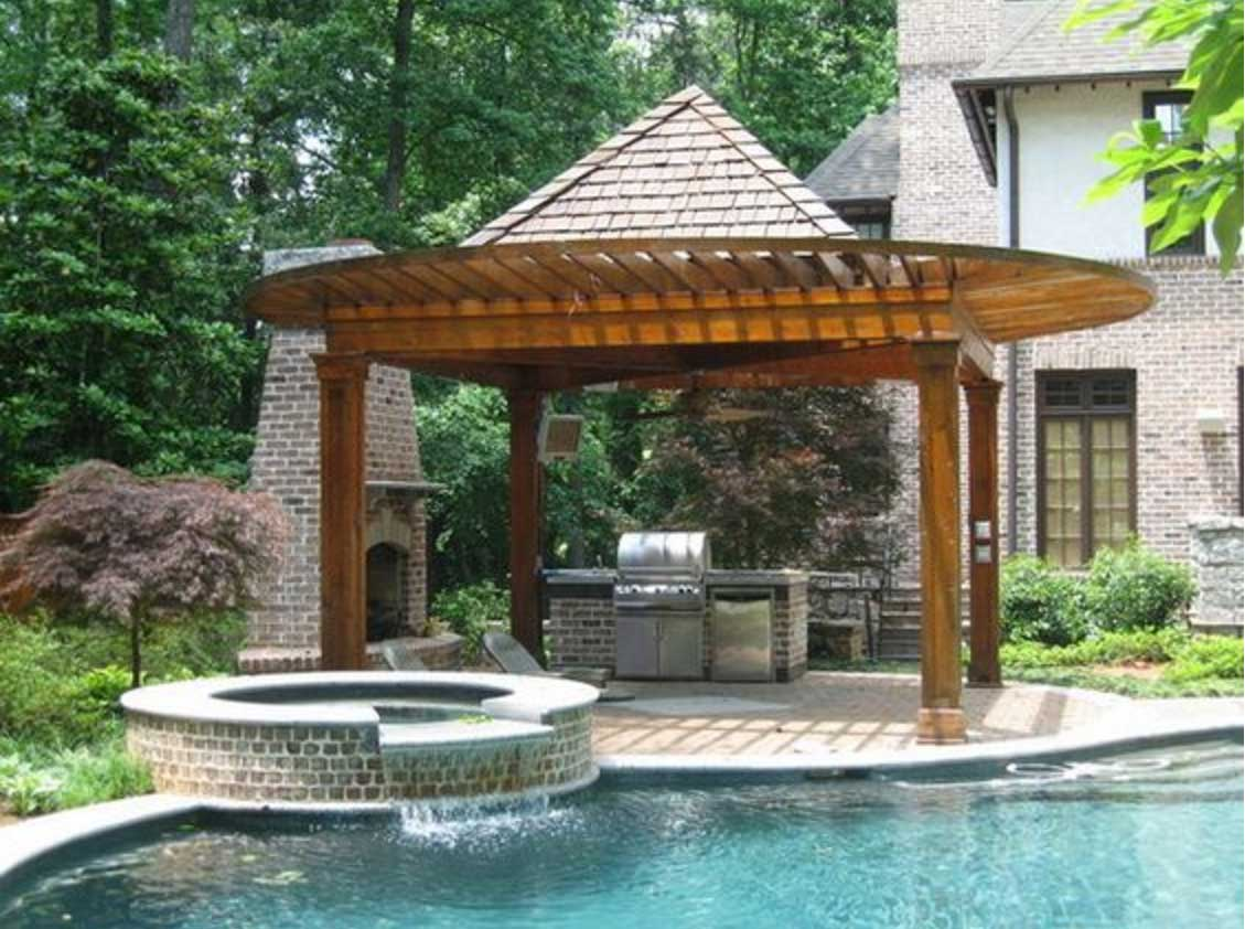 outdoor kitchen and pool photo - 6