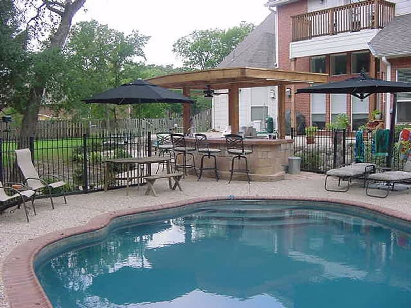 outdoor kitchen and pool photo - 7