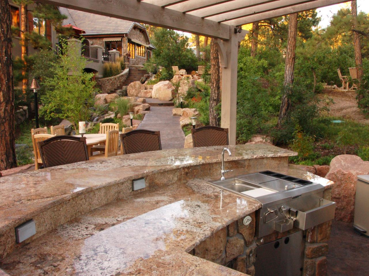 outdoor kitchen with bar photo - 2