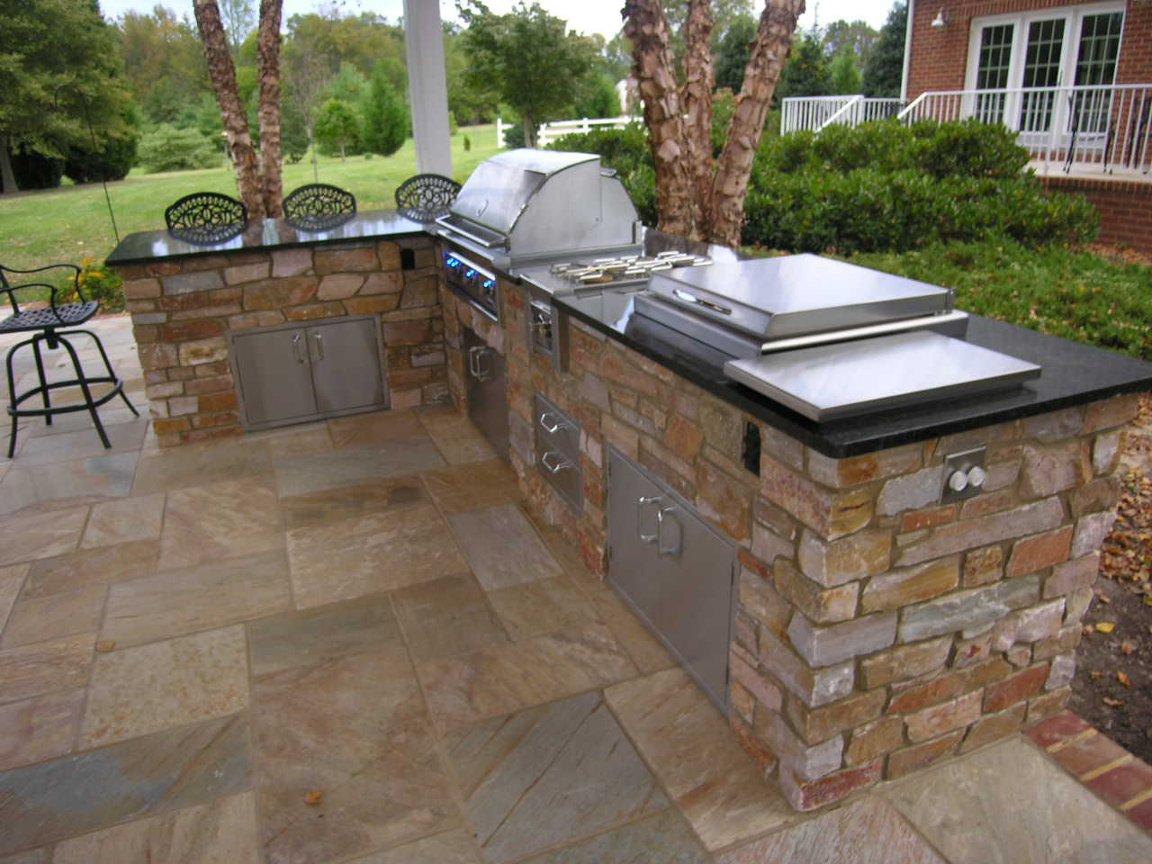 outdoor kitchen with bar photo - 3