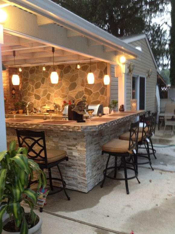 outdoor kitchen with bar photo - 7