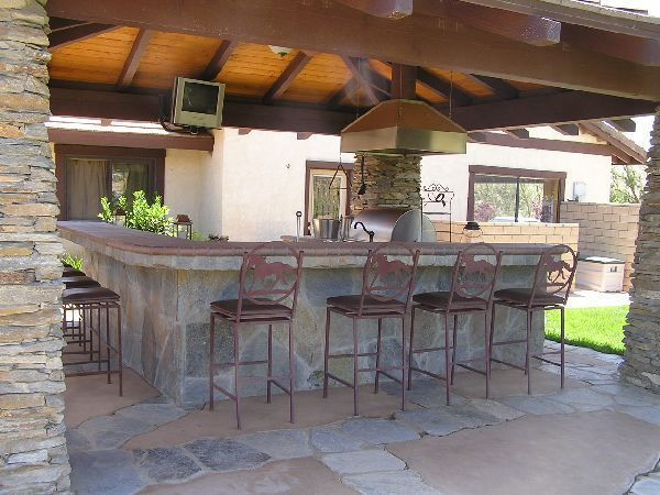 outdoor kitchen with bar photo - 8