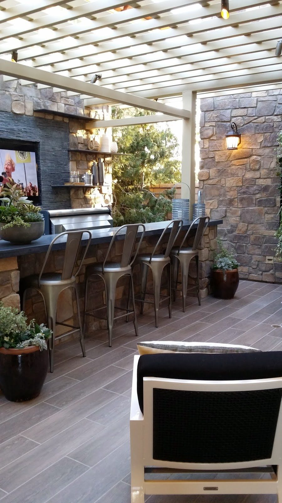 outdoor kitchen with bar photo - 9