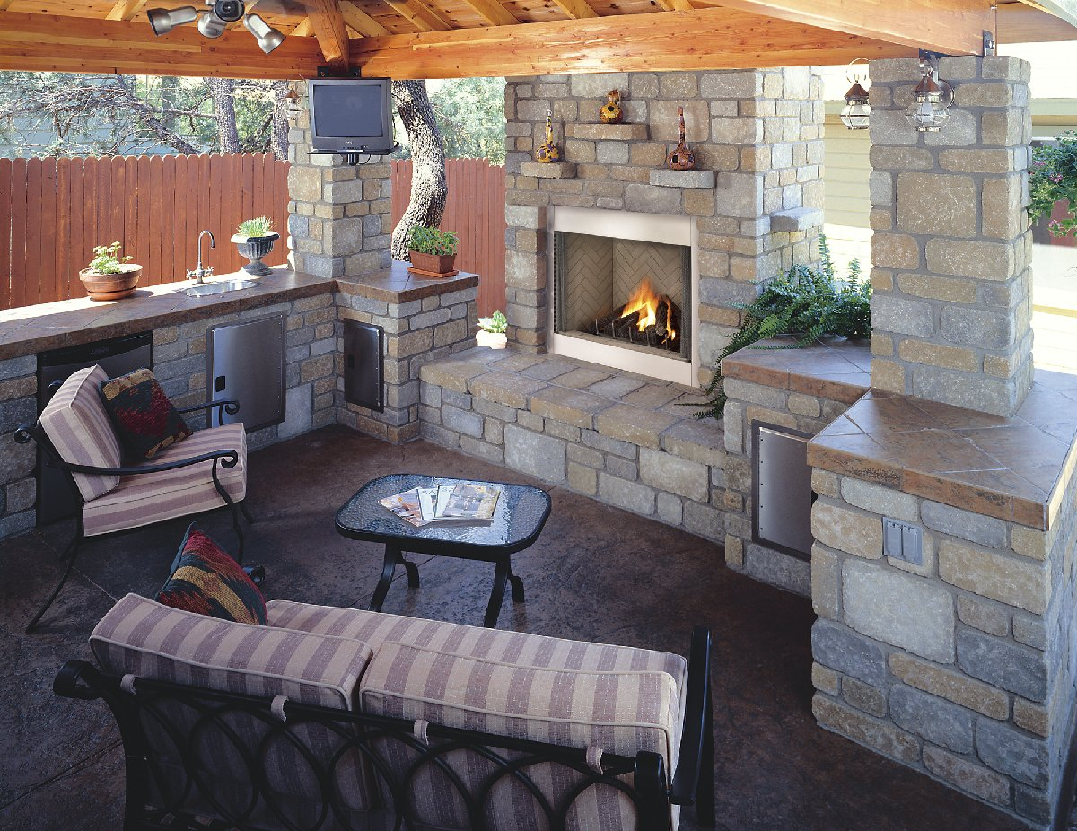 outdoor kitchen with fireplace photo - 1