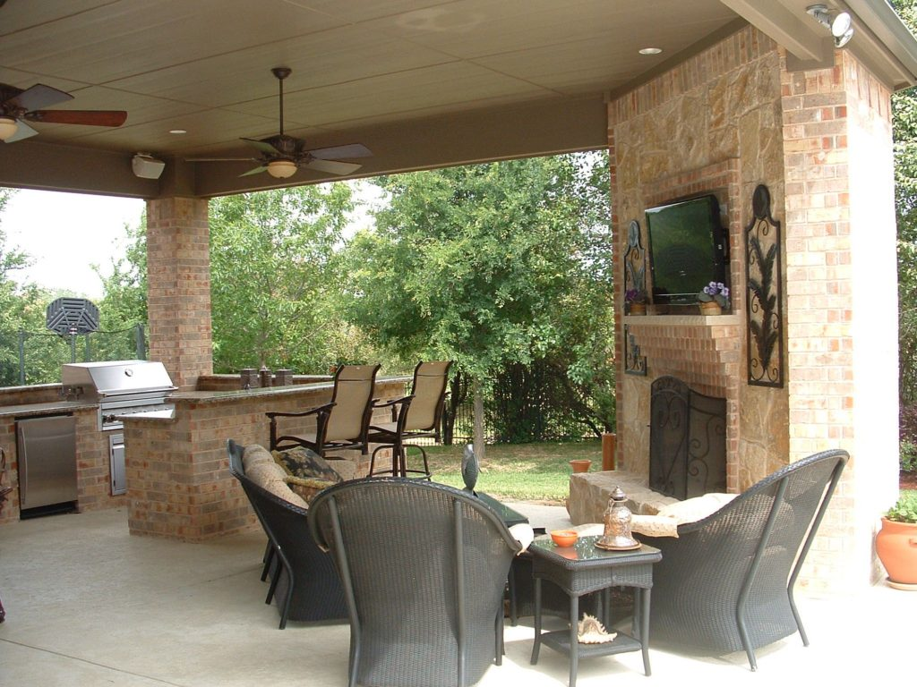 outdoor kitchen with fireplace photo - 10