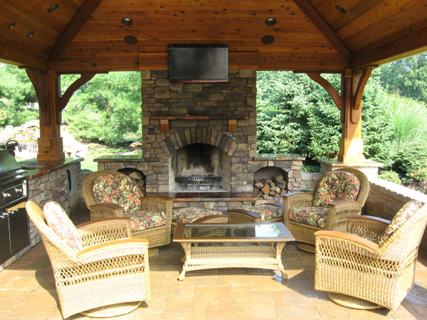 outdoor kitchen with fireplace photo - 3