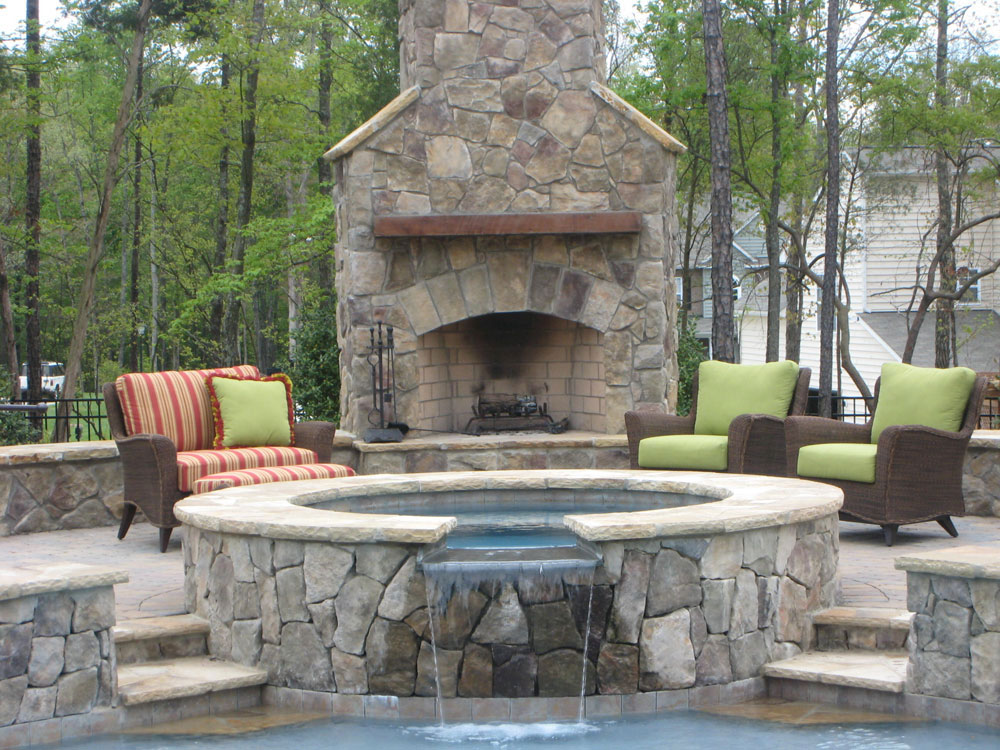 outdoor kitchen with fireplace photo - 8