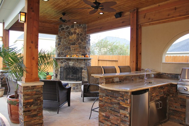 outdoor kitchen with fireplace photo - 9