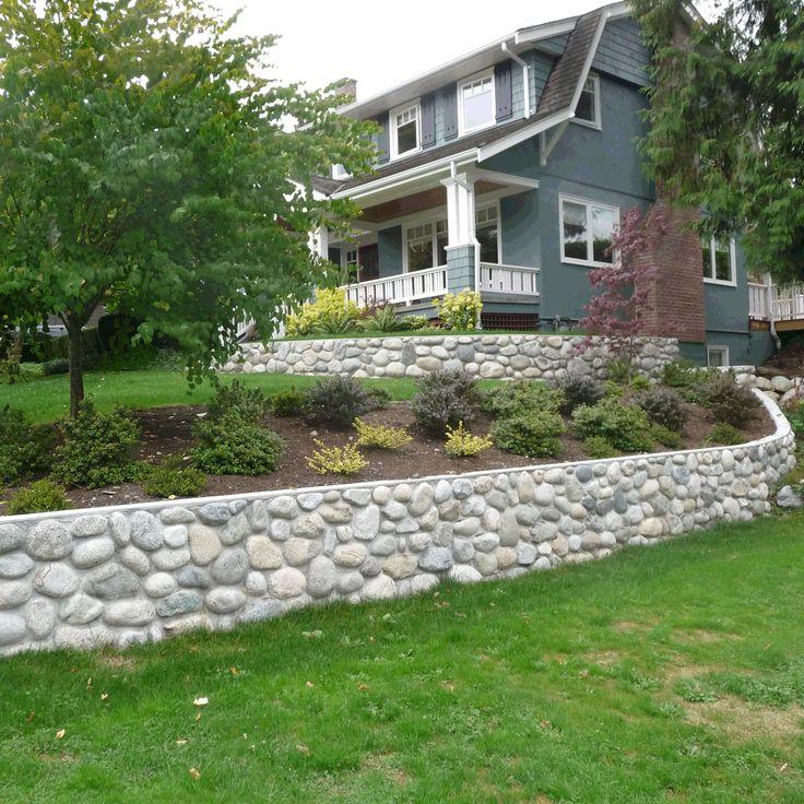 river rock garden wall photo - 1