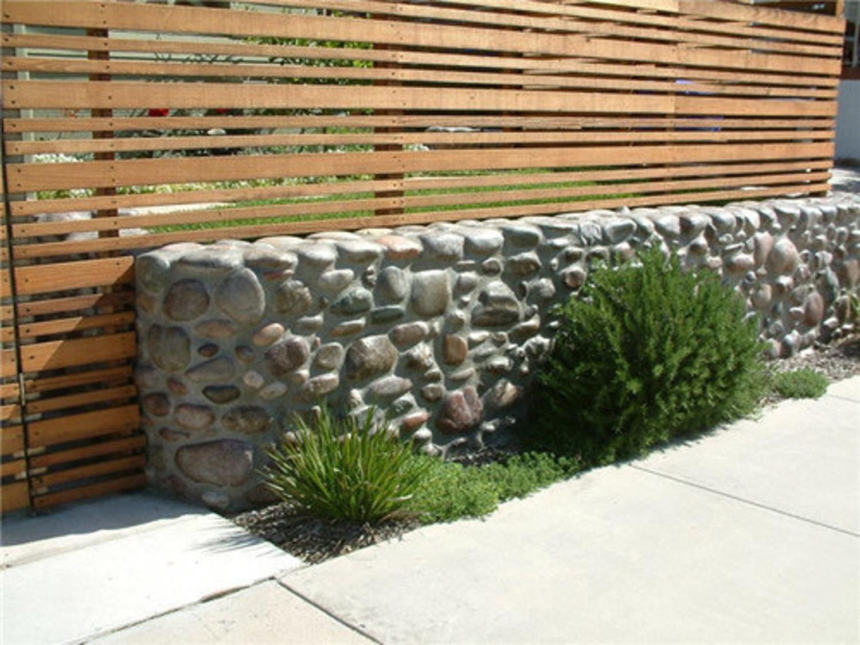 river rock garden wall photo - 2