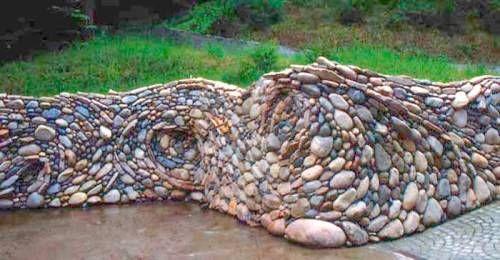 river rock garden wall photo - 3