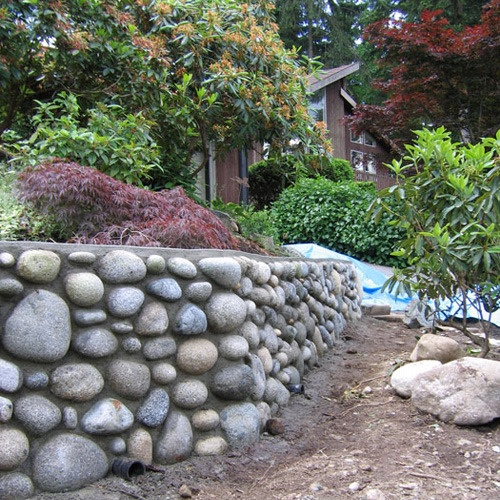 river rock garden wall photo - 4
