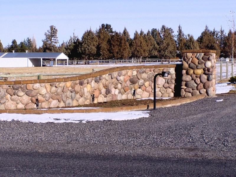 river rock garden wall photo - 7