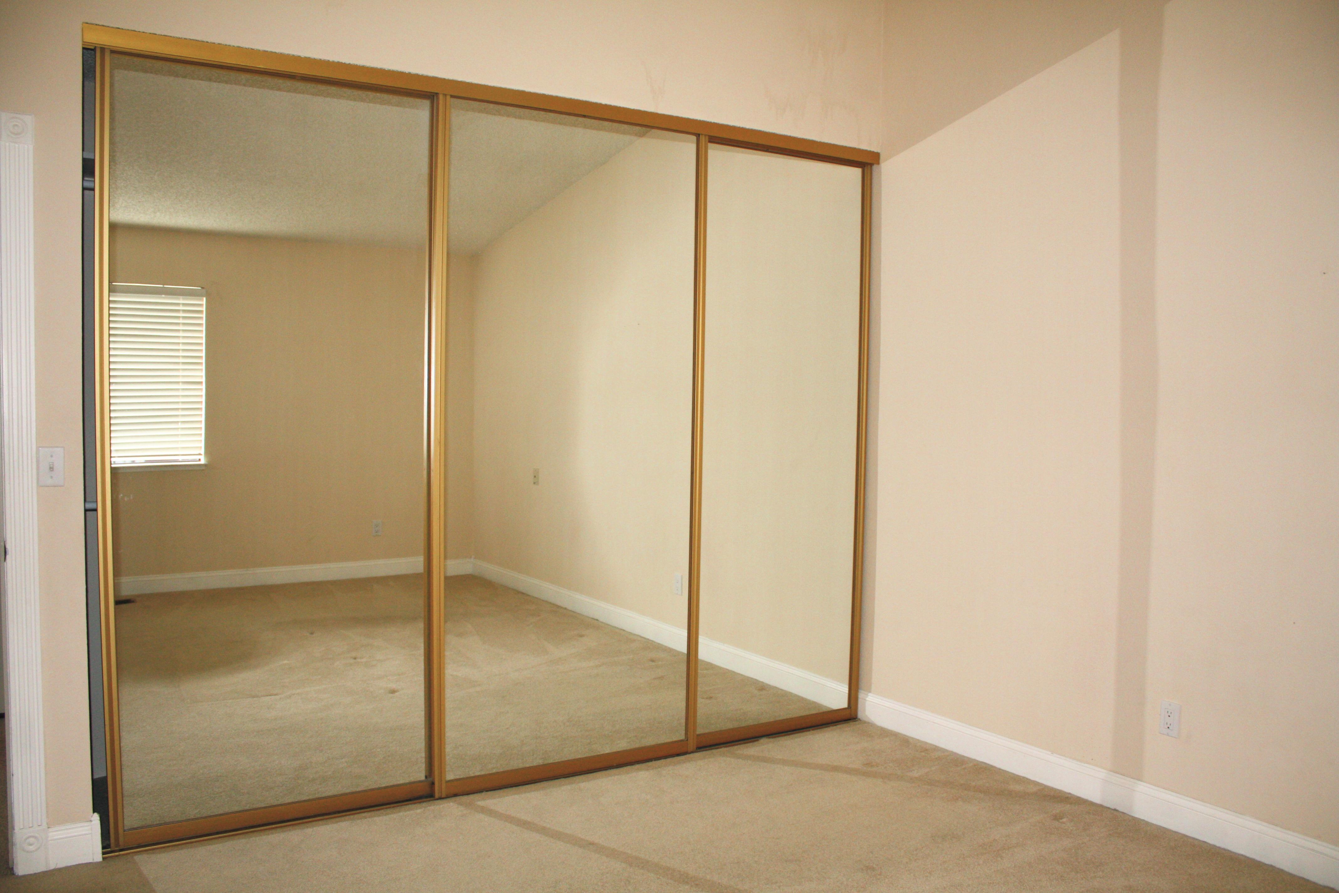 sliding glass mirrored closet doors photo - 8