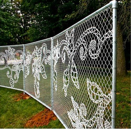 vegetable garden chain link fence photo - 2